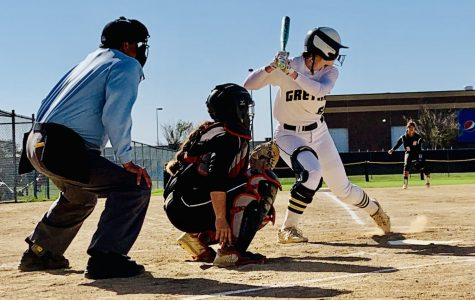 Stepping Up To The Plate: Senior taking the swing. Billie Andrews (20) gets ready for the hit as she is in her batting stance. She is seconds away from either a strike or a hit.