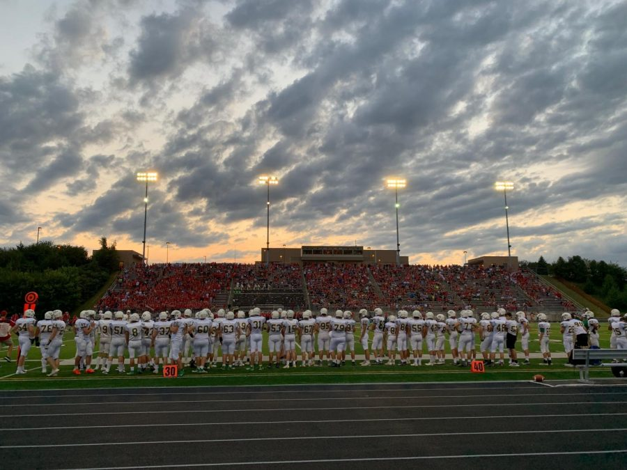 The Dragons lined up on the sideline during the game against Millard South.