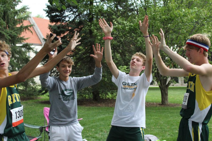 Sophomores Evan Liewer,  Josh Arend, and Simon Kerr have some fun with junior Andrew Swanson before their races.