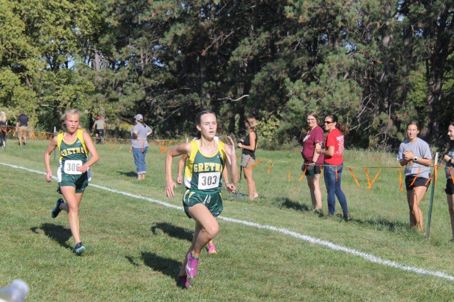 Senior Kayla Adams and sophomore Regan Ehlert battle to the finish line.