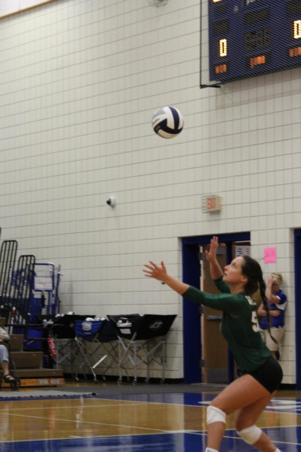 Senior libero Kennedy Shaechar serves a jump float serve to Marian and gets them out of system.