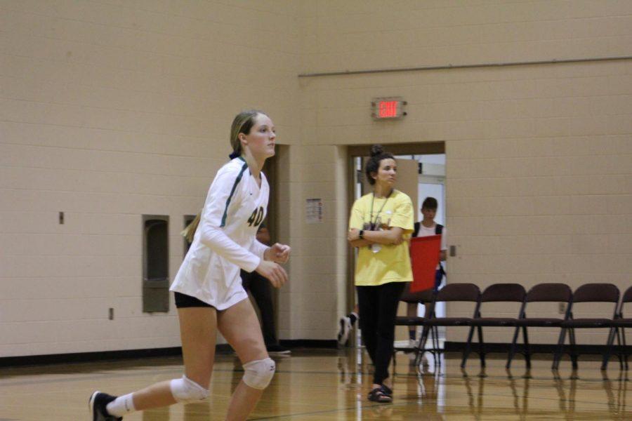 Freshman Malia Struve runs to help her team after serving.