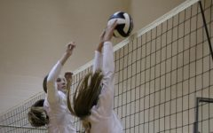 Freshman Malia Struve jumps in order to block the ball.