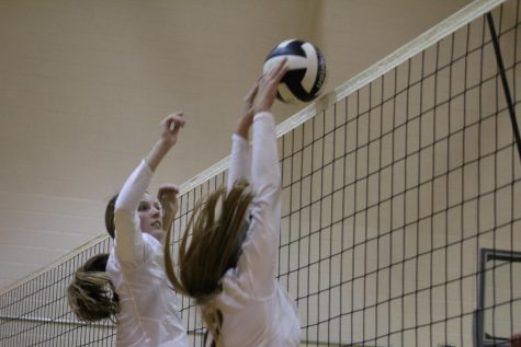 Freshman Malia Struve jumps in order to block the ball.