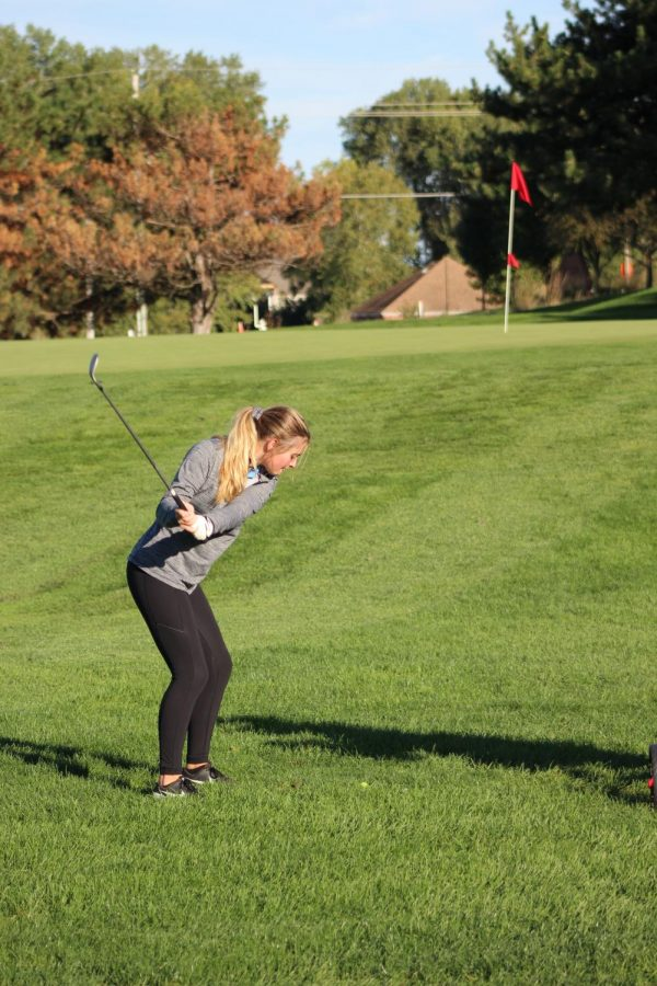 Junior Samantha Randels winds up to hit the ball onto the green.