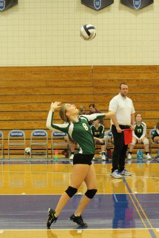 Freshmen Hannah Wassenaar prepares to  serve the ball.