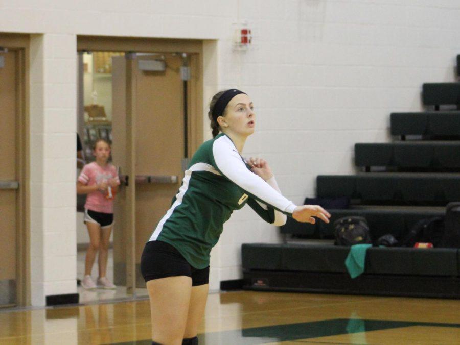Freshmen Jenna Keasling hits the ball.