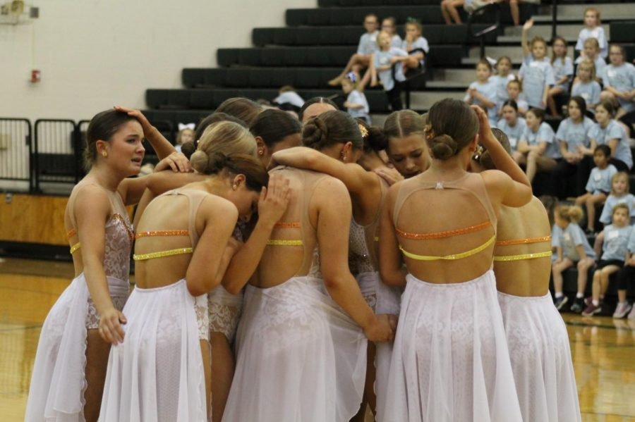 The girls come together after their dance dedicated to Kloe Odermatt, Abby Barth, Alexandria Minardi, and Addisyn Pfeifer at the GHDT showcase on 12/7.