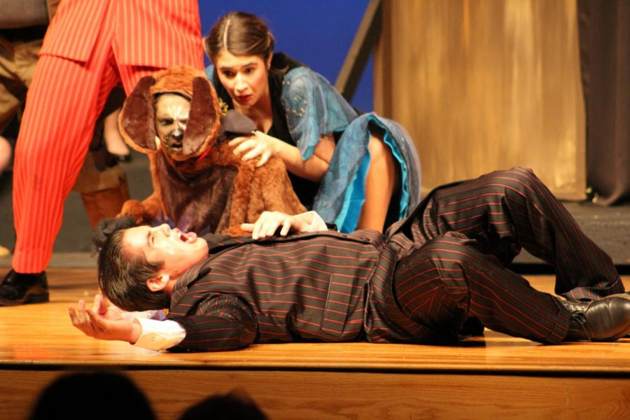 Lying on the stage, senior Timothy Huber dies while seniors Paige Pulte and Payton Plugge watch.