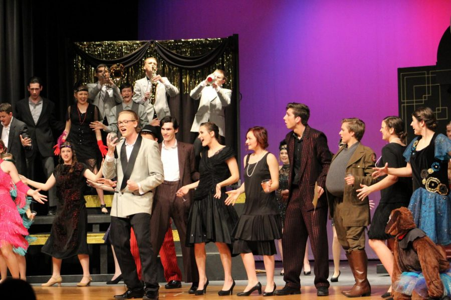 Curtain Call: As the production comes to an end, Jonah Bricker (20) and the rest of the ensemble all gather on stage.