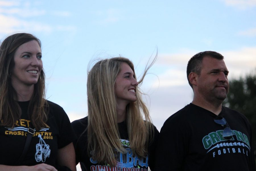 Senior Kaylee Moore smiles proudly as she walks the track for senior night.