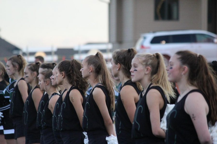 The girls line up before their half time show during the home football game vs Westside High School.