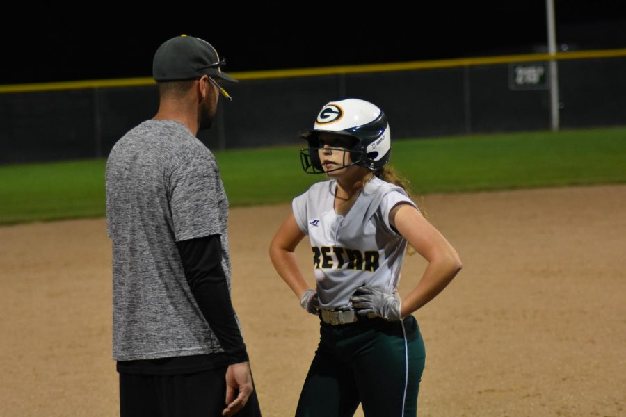 Senior Alyssa Morbach gets talked to by her coach by third base.