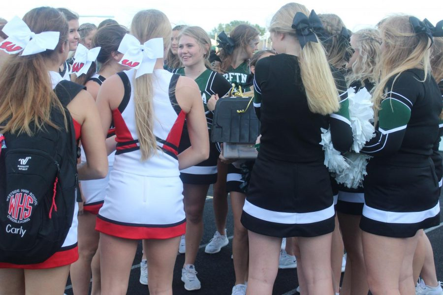 The team gets acquainted with the Westside team before the football game begins.