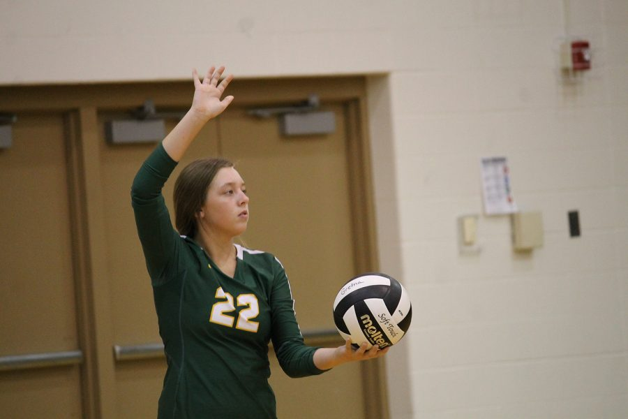 Sophomore Avery Edwards gets ready to serve. Photo by: Kalei Renner.