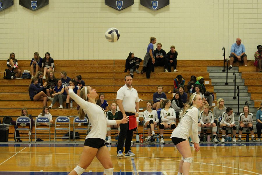 Juniors Karlee Lobsiger and Josie Mason get ready to hit it back.