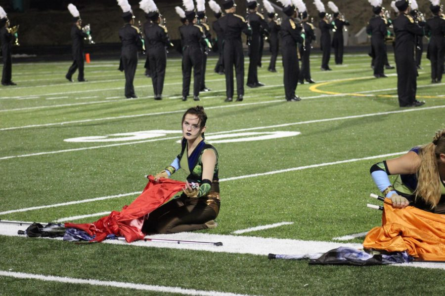 Sophomore Reagan Kahla performs in the colorguard. (Photo by: Delany Jepsen)