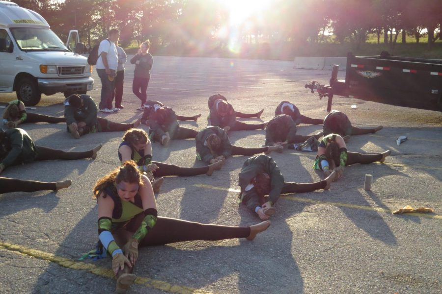 The cologuard stretches before they practice. (Photo by: Mary Matya)