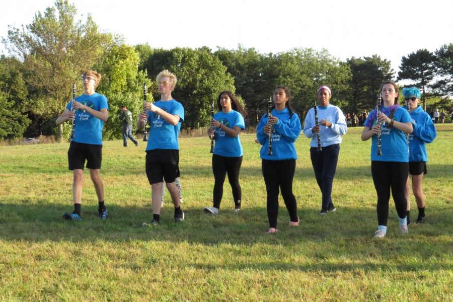 The woodwind players practice the movements. (Photo by: Mary Matya)