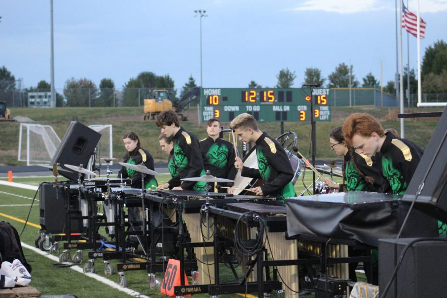 The percussion players perform their part.