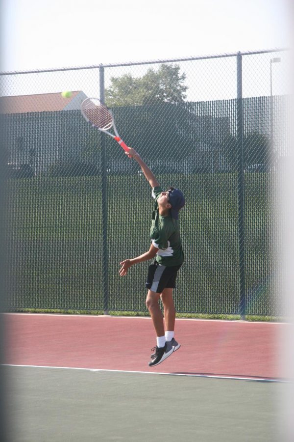 Junior Micah Bernal plays for varsity during the home game against Papillion La Vista High School. Bernal was the number one singles player this year.