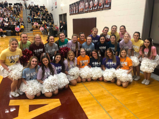 Both Gretna and Papillion-La Vista cheerleaders are all wearing their Color of Hope Shirts. The two teams came together to take a picture and show awareness to all cancers. They cheered for both the girls and boys varsity basketball teams.