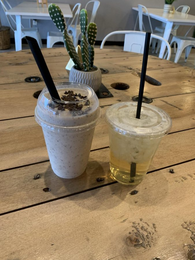 Healthy Drinking: An iced green tea and a chocolate chip cookie dough shake sit at one of the many texturized tables inside 402 Nutrition. These two drinks are what are included inside the combo meal. The shake serves as a meal replacement, and the tea acts as a drink for the meal.