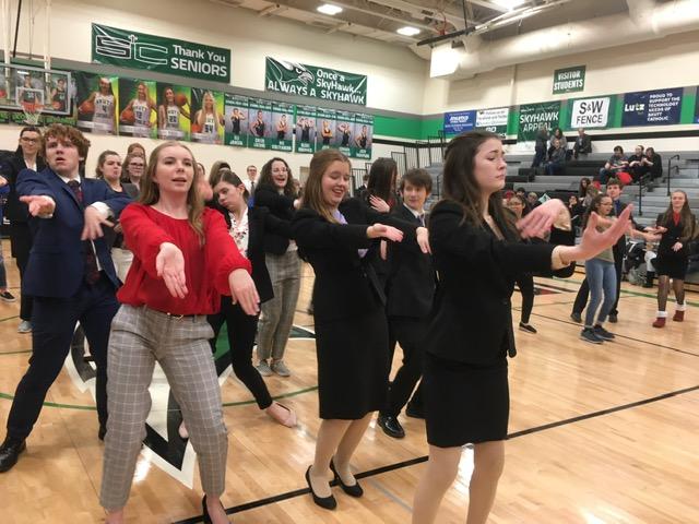 Dancing The Night Away- The speech team dances the Macarena at the Skutt Catholic High School meet.