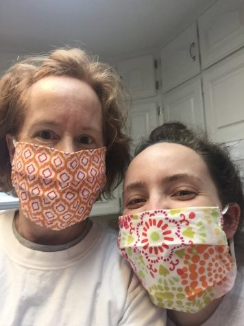 Mother and Daughter: Mrs. Rhodes and her daughter, Lauren wear their masks as they prepare to go for their weekly grocery shopping trip. They made the masks from the material that used to be on the bulletin boards in Mrs. Rhodes' classroom.