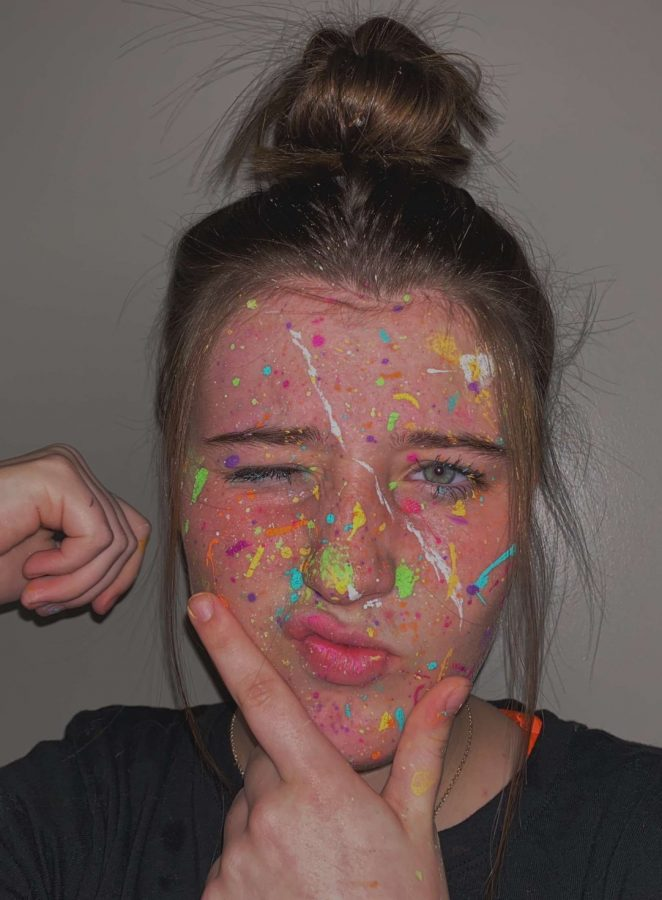 Freshman+Chloe+Endghal+used+her+time+to+create+a+piece+of+art+on+her+face.+She+used+paint+to+create+a+colorful+design.