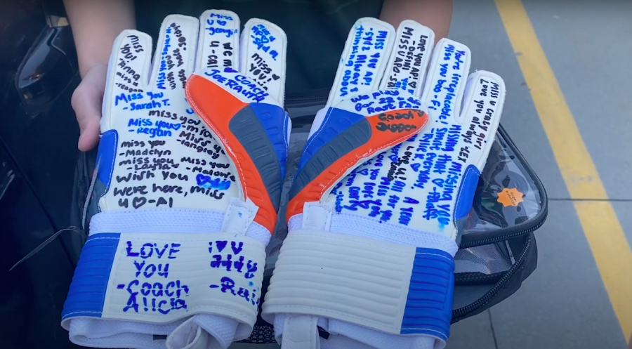 Teammates+and+coaches+signed+gloves+in+remembrance+of+Addisyn.+