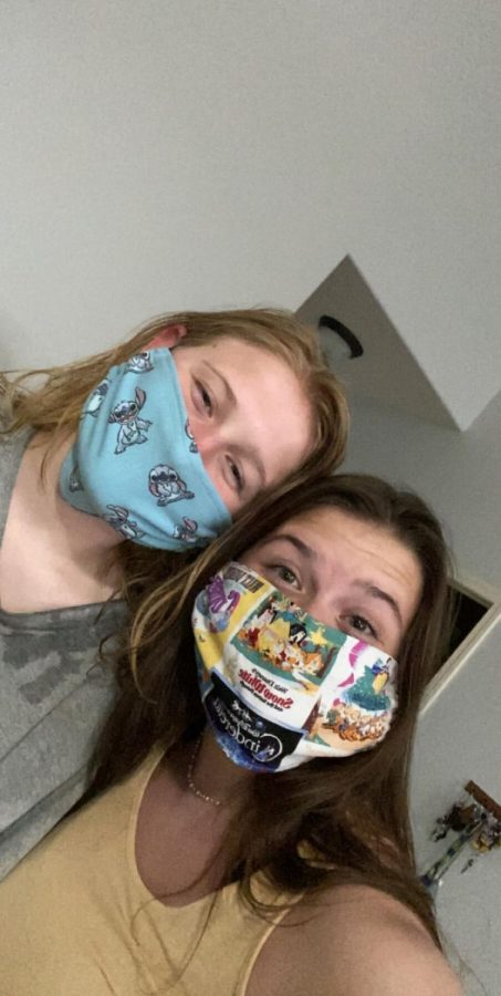 Sibling Love: Elizabeth Daily (20) and her sister, Rachel, pose together wearing their masks.