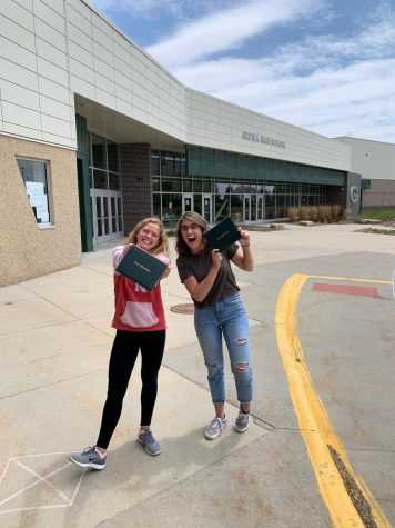 Seniors Jada Scharff (left) and Peyton Plugge (right) holding their diplomas in front of Gretna High School on May 12 one of the senior sign out days.