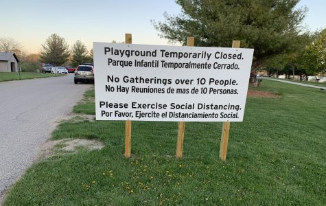 Staying Healthy: At Zorinsky lake, a sign towards the entrance of the lake shows a list of social distancing guidelines in both the Spanish and English language. In order to be practicing proper social distancing, lake users must avoid gathering in groups of 10, using the public playground and being in another person's 6 feet of space.