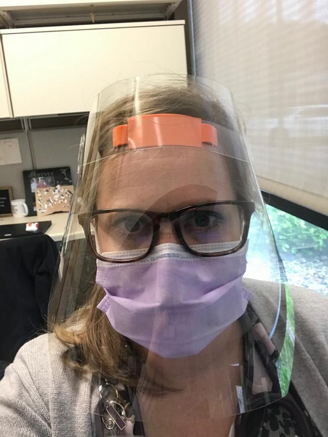 Mrs.+Rochelle+Schuka+at+work+while+wearing+her+necessary+mask+in+order+to+keep+her+and+her+patients+safe.+She+works+at+the+Children%27s+Clinic+as+a+nurse+practitioner.