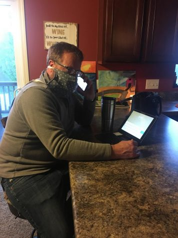 Mr. Kenneth Russell working from home while all on a call for his job.