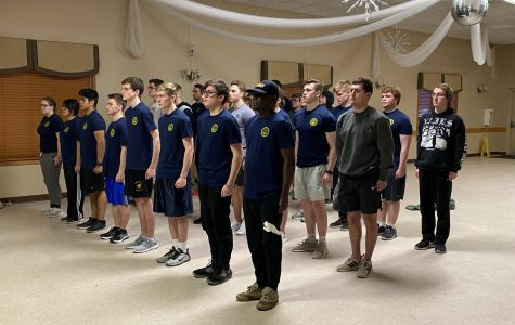Members from the Omaha area stand at attention as they are given instructions.