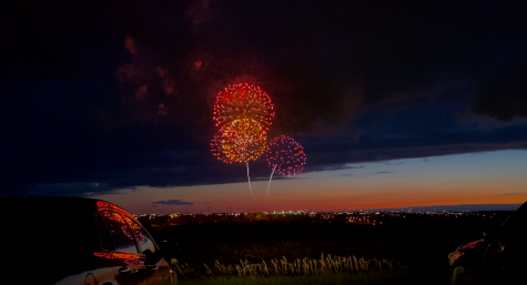 On a hill overlooking Werner park, community members watch a drive-in firework show that Werner park hosted on May 8th.