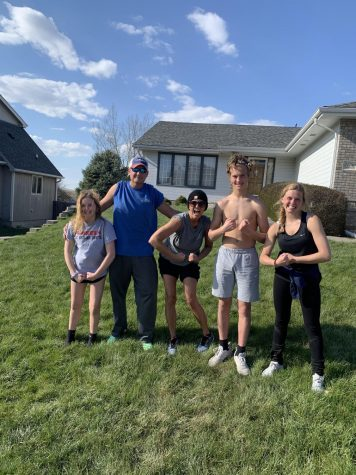 Jada Scharff (on the right) and her family at her house before running 26 miles in 26 hours.