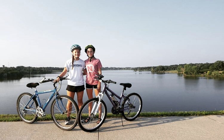 Taking the Off Days Easy- Grace (22) and Rachel Pemberton (24) bike around Wehrspann Lake after a difficult workout.   I think biking is the best type of cross training for running,