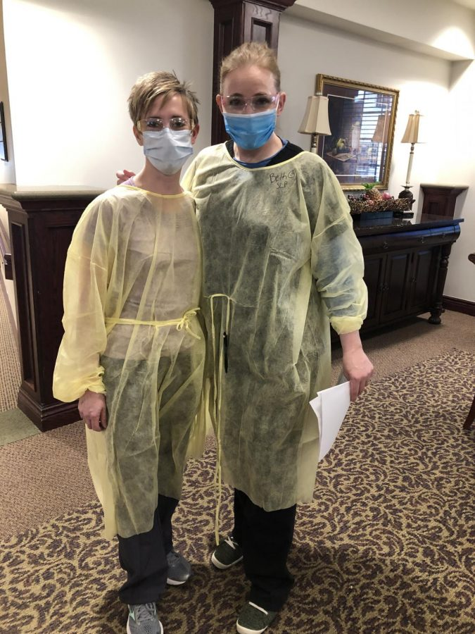 Gina Foltz and Beth Hopkins fully dressed in their personal protective equipment.
