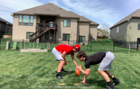 In The Backyard: Tanner Hall (21) and his brother Evan Hall (23) practice their defensive line drills.