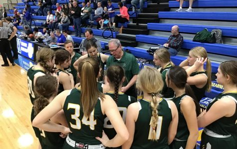Coach Skrdla preparing his team for the second half of the game against Kearney High School. The Lady Dragons defeated Kearney High School
