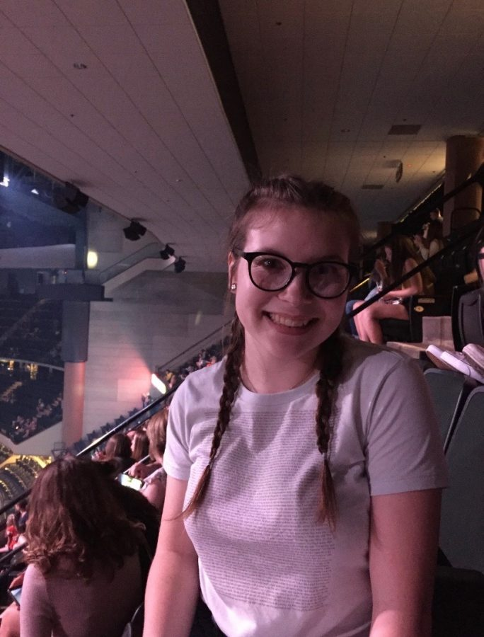 At the Xcel Energy Center in Saint Paul, Minnesota, Miranda Parkinson (21) is  attending a Harry Styles concert.