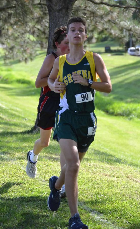 Every Hill Counts- Bradley Sullivan (20) pushes at the end his cross country race at the Plattsmouth Invite.