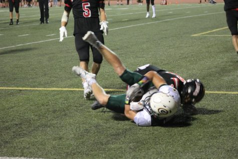 """Secure the Catch: After intially sending the field goal team on the field, head coach Mr. Mike Kayl decides to go for it on fourth and goal. """"I tracked the ball through the air and came down with it for the touchdown,"""" senior Trevor Marshall said. The score pushed the Dragon"""