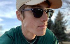 Sense of Adventure: While heading across campus, Ben Randall (19) rides his bike.
