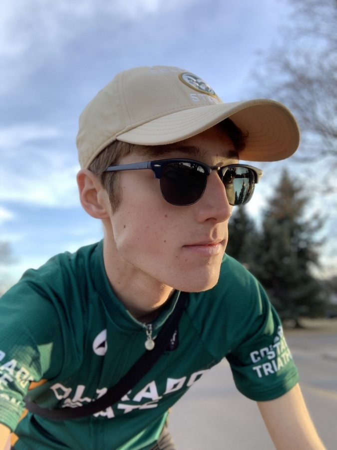 Sense of Adventure: While heading across campus, Ben Randall (19) rides his bike.