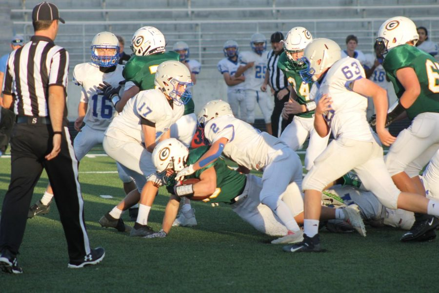 Push On: As Isaiah Weber (24) dives forward, number 66 Bennet Stock (24) looks on after giving him a block.