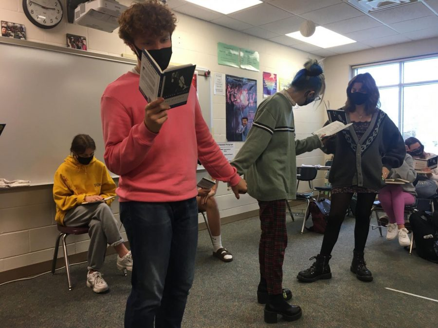 """Lights, Camera, Action Performing The Crucible, Charles Sams (22) says his lines. """"It is a good play people should read,"""" Sams said. """"It is still relevant today about how people can be pitted against each other."""" His favorite character was Abigail."""